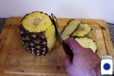 Cutting off the pineapple skin