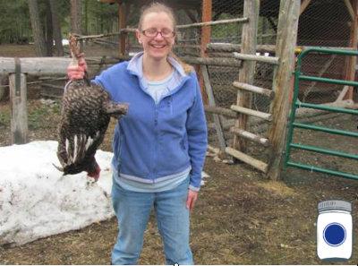 Chaya holding a chicken