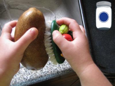 little hands scrubbing veggies