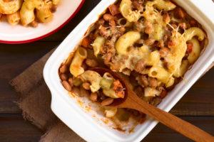 Chili con carne and macaroni pasta casserole in baking